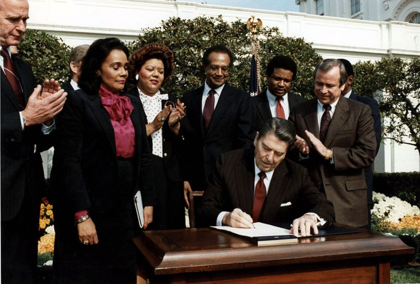 1024px-reagan_signs_martin_luther_king_bill